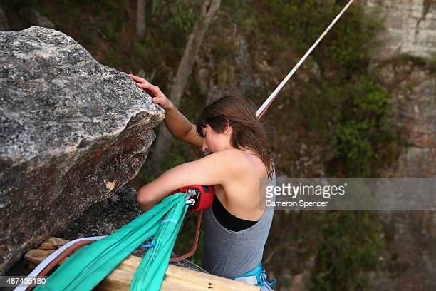 Gabriela Ivanac of Chile shows her exhaustion after walking on a highline rigged between cliffs at Corroboree Walls in Mount Victoria on March 7 2015...