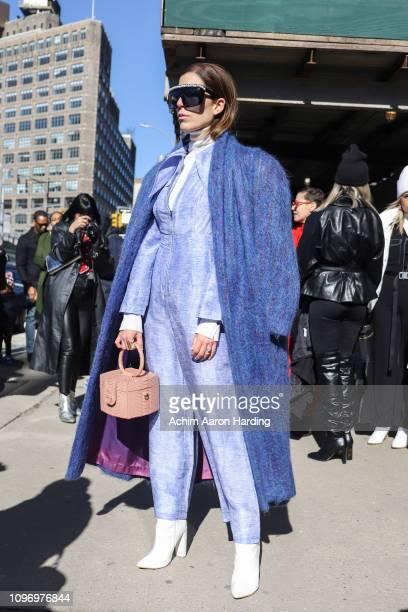 Gabriela Medina is seen wearing a blue MSGM coat, light blue Simonett jumpsuit and a Ximena Kavalekas bag on the street during New York Fashion Week...