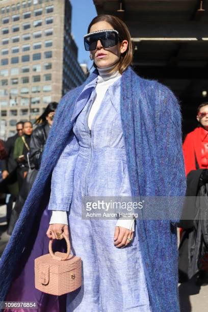 Gabriela Medina is seen wearing a blue MSGM coat light blue Simonett jumpsuit and a Ximena Kavalekas bag on the street during New York Fashion Week...