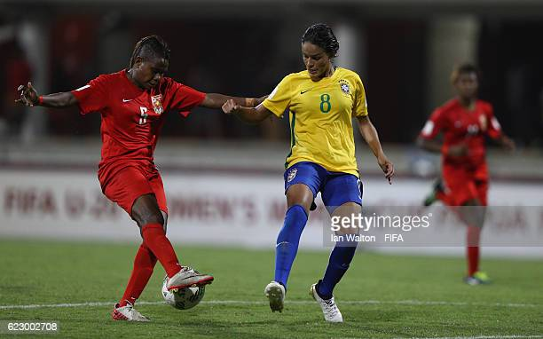 Gabriela Nunes Da Silva of Brazil tories to tackle Hilda Nake of Papua New Guinea during the FIFA U20 Women's World Cup Group A match between Papua...