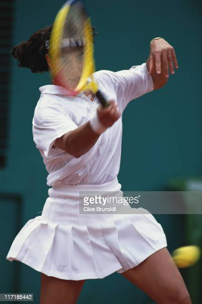 Gabriela Sabatini of Argentina makes a return against Steffi Graf during their Women's Sngles quarter final match during the French Open Tennis...