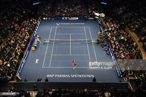 Gabriela Sabatini serves against Monica Seles during the BNP Paribas Showdown on March 10 2015 at Madison Square Garden to celebrate the 25th...