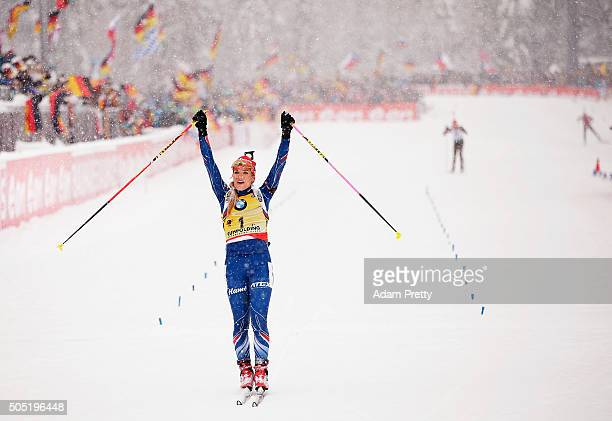 Gabriela Soukalova of the Czech Republic celebrates as she crosses the finish line to claim victory in the Women's 125km Biathlon race of the...