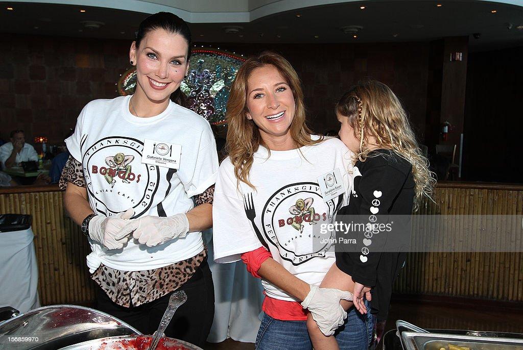 Gabriela Vergara and Geraldine Bazan participate in 5th Annual Thanksgiving Feed A Friend at Bongos on November 22, 2012 in Miami, Florida.