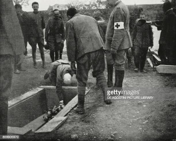 Gabriele D'Annunzio putting flowers on Giovanni Randaccio's coffin Italy World War I from L'Illustrazione Italiana Year XLIV No 24 June 17 1917