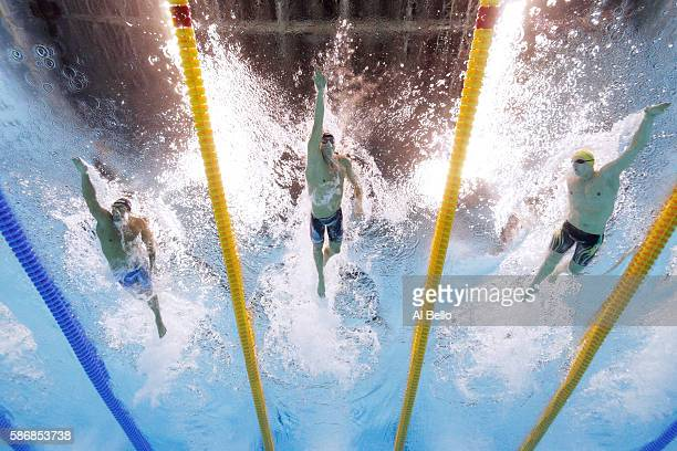 Gabriele Detti of Italy Conor Dwyer of the United States and Mack Horton of Australia compete in the Final of the Men's 400m Freestyle on Day 1 of...