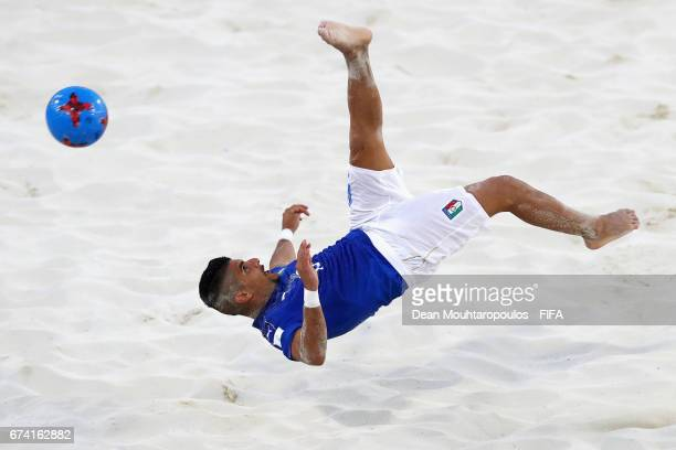 Gabriele Gori of Italy scores with a scissor or bicycle kick shot on goal during the FIFA Beach Soccer World Cup Bahamas 2017 group B match between...