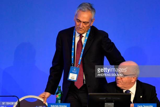 Gabriele Gravina one of the three candidates to the presidency of the Italian Football Federation reacts next to outgoing FIGC President Carlo...