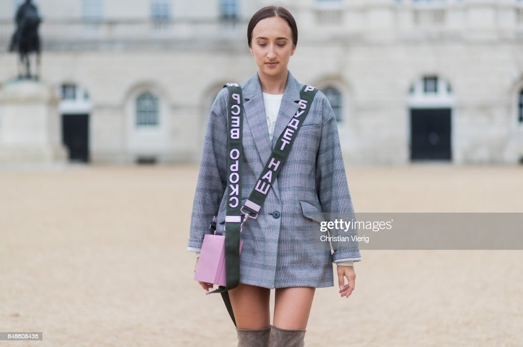 Gabriele Gzimailaite wearing oversized checked grey blazer, a pink Alexandra Druzhinin bag with olive strap, olive overknee boots during London Fashion Week September 2017 on September 17, 2017 in London, England.