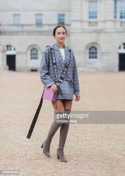 Gabriele Gzimailaite wearing oversized checked grey blazer a pink Alexandra Druzhinin bag with olive strap olive overknee boots during London Fashion...