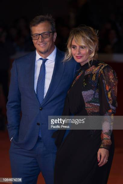 Gabriele Muccino and Angelica Russo walk the red carpet ahead of the 'Notti Magiche' screening during the 13th Rome Film Fest