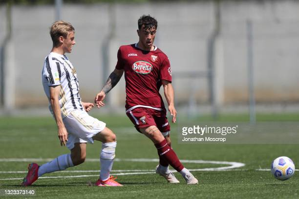 Gabriele Mulazzi of Juventus challenges Mattia La Marca of Torino FC during the Primavera 1 TIM match between Torino U19 and Juventus U19 at Centro...
