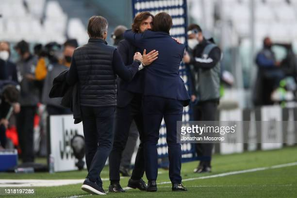Gabriele Oriali Internazionale First Team Technical manager looks on as Andrea Pirlo Head coach of Juventus embraces Antonio Conte Head coach of...