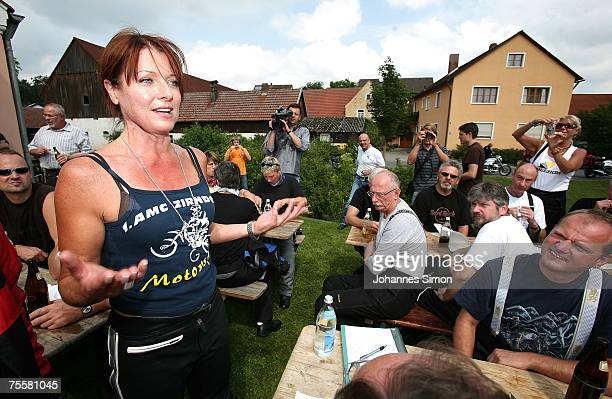 Gabriele Pauli district administrator of the Bavarian district Fuerth delivers a speech taking part on a village feast during a motorcycle tour on...