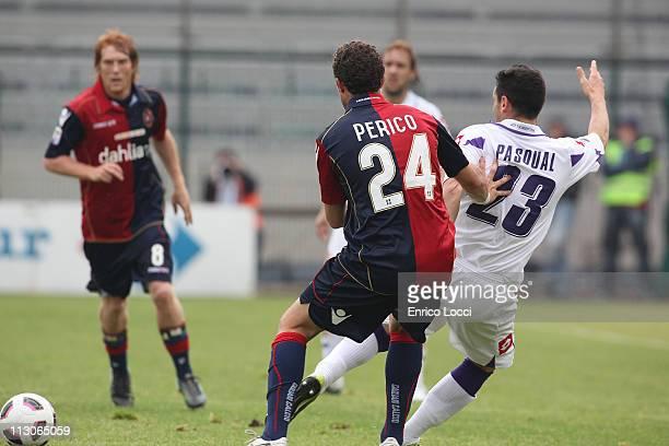 Gabriele Perico of Cagliari and Pasqual Manuel during the Serie A match between Cagliari Calcio and ACF Fiorentina at Stadio Sant'Elia on April 23...