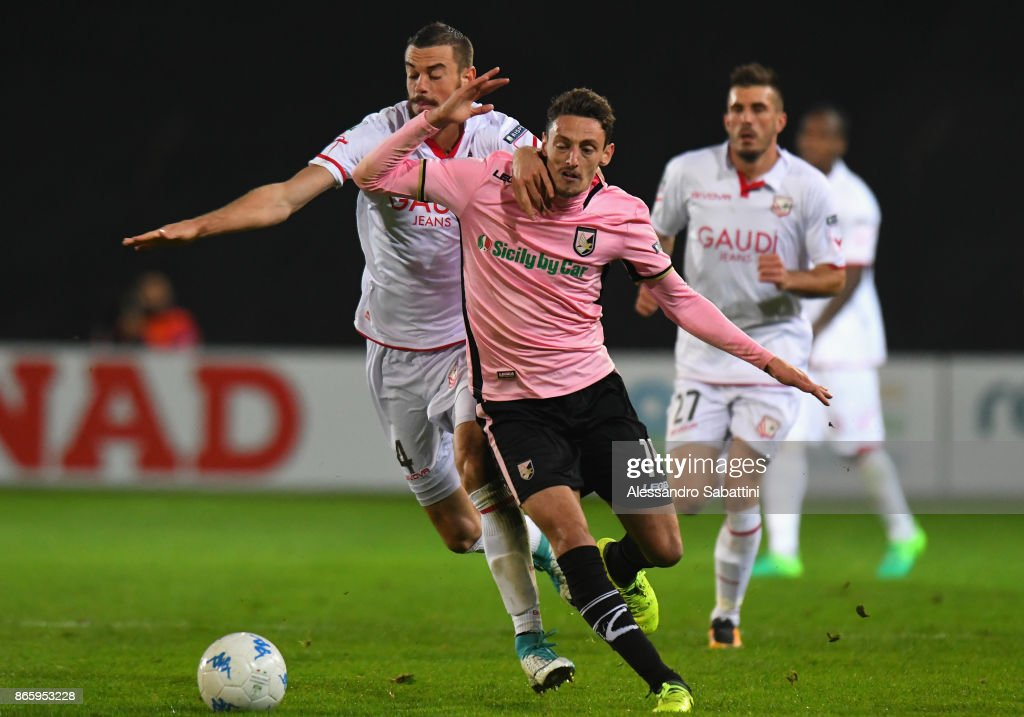 Gabriele Rolando (R) of US Citta di Palermo competes for the ball whit Alessio Sabbione of FC Carpi during the Serie B match between FC Carpi and US Citta di Palermo on October 24, 2017 in Carpi, Italy.