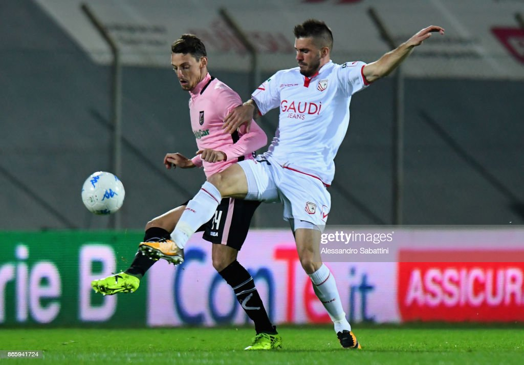 Gabriele Rolando of US Citta di Palermo competes for the ball with Enej Jelenic of FC Carpi during the Serie B match between FC Carpi and US Citta di Palermo on October 24, 2017 in Carpi, Italy.