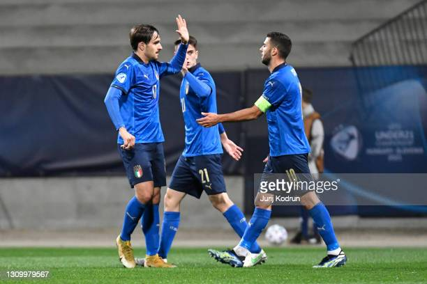 Gabriele Zappa and Patrick Cutrone of Italy celebrate after team mate Giacomo Raspadori scored their side's second goal during the 2021 UEFA European...