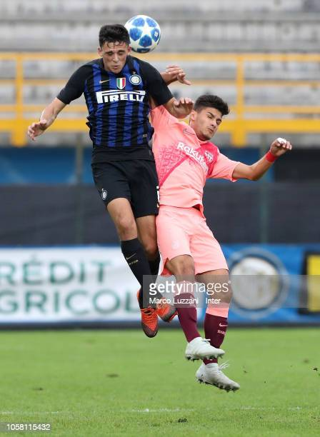 Gabriele Zappa of FC Internazionale competes for the ball with Nils Mortimer of FC Barcelona during the match of the UEFA Youth League between FC...