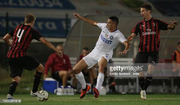 Gabriele Zappa of FC Internazionale competes for the ball with Tommaso Merletti of AC Milan during the Trofeo Mamma Cairo match between FC...