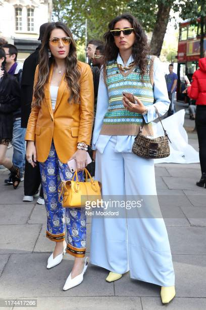 Gabriella Berdugo in blue flared trousers poses on arrival at BFC showspace during London Fashion Week September 2019 on September 13, 2019 in...