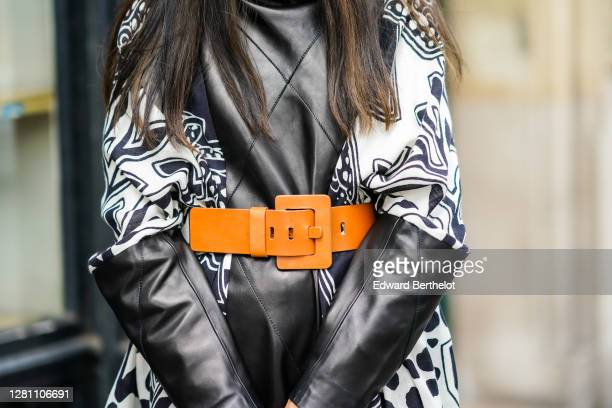 Gabriella Berdugo is wearing a black and white patchwork leather dress from Barbara Bui with brown maxi bucket belt from jacquemus , printed monogram...