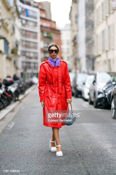 Gabriella Berdugo is wearing a red leather trench coat from MSGM with purple Peter Pan organza collar and white turtleneck pullover in layering, a...