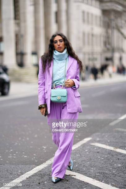Gabriella Berdugo wears earrings a pale blue wool oversized turtleneck pullover an oversized pale purple blazer jacket a quilted Chanel bag flared...