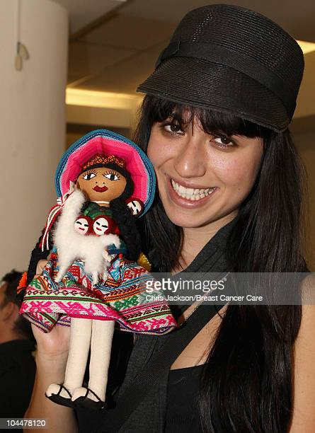 Gabriella Cilmi smiles as she poses with a doll inside her hotel ahead of Denise and Fearne's Charity Trek for Breast Cancer Care on September 26...