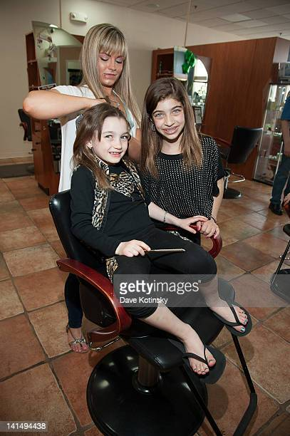 Gabriella Giudice get braids in her hair beside Gia Giudice at the Kaleidoscope Hair Body Artistry open house on March 17 2012 in Basking Ridge New...