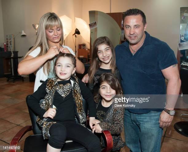 Gabriella Giudice get braids in her hair beside Gia Giudice Milania Giudice and Joe Giudice at the Kaleidoscope Hair Body Artistry open house on...