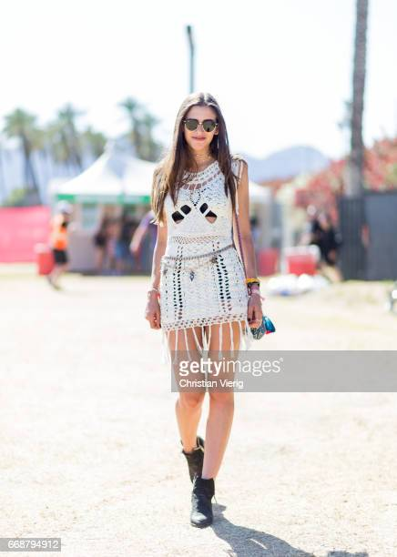 Gabriella Glover wearing a white fringed dress black boots during day 1 of the 2017 Coachella Valley Music Arts Festival Weekend 1 on April 14 2017...