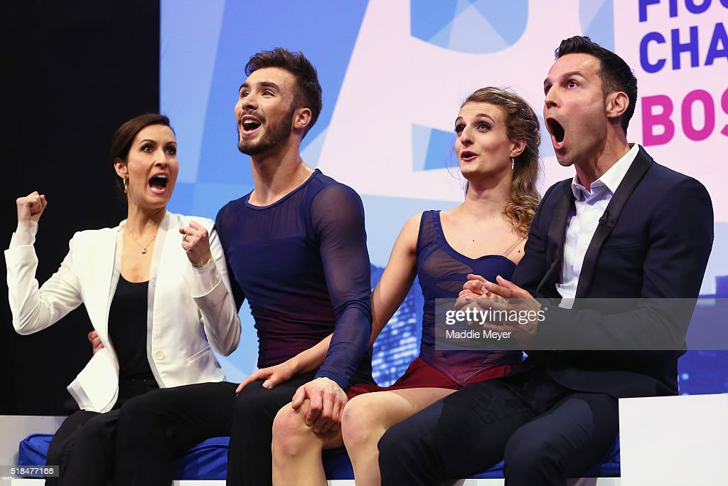 Gabriella Papadakis and Guillaume Cizeron of France celebrate their score in the Free Dance Program with their coaches Marie-France Dubreuil, left, and Romain Haguenauer, right, during Day 4 of the ISU World Figure Skating Championships 2016 at TD Garden on March 31, 2016 in Boston, Massachusetts.