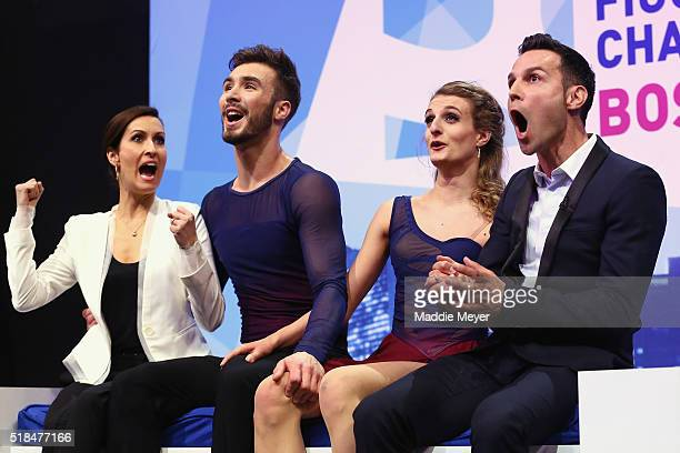 Gabriella Papadakis and Guillaume Cizeron of France celebrate their score in the Free Dance Program with their coaches MarieFrance Dubreuil left and...