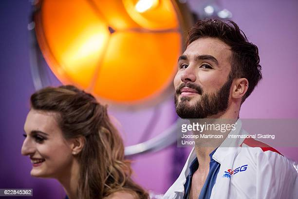 Gabriella Papadakis and Guillaume Cizeron of France look on at kiss and cry after competing in Ice Dance Free Dance on day two of the Trophee de...