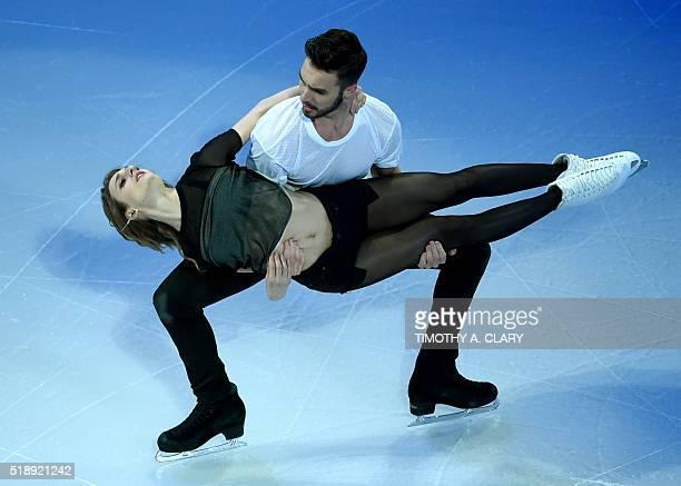 Gabriella Papadakis and Guillaume Cizeron of France skate during the Exhibition of Champions program at the ISU World Figure Skating Championships at...