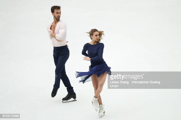 Gabriella Papadakis and Guillaume Cizeron of the United States reacts after compete in the Ice Dance Free Dance on day two of Audi Cup of China ISU...