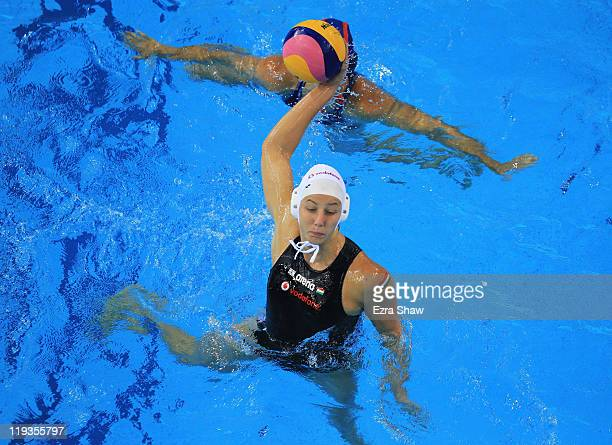 Gabriella Szucs of Hungary attempts a shot against the United States as they compete in the Women's Water Polo first preliminary round match on Day...
