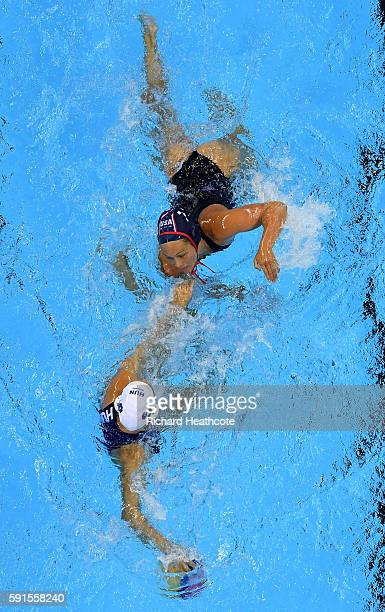 Gabriella Szucs of Hungary battles with Courtney Mathewson of USA during the Women's Water Polo semi final match between Hungary and USA at Olympic...