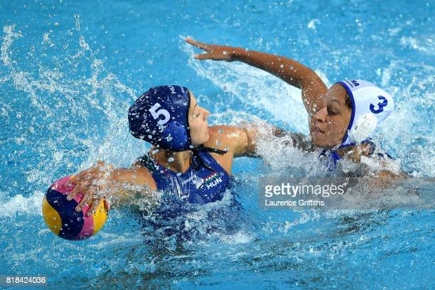 Gabriella Szucs of Hungary is challenged by Lea Bachelier of France during the Women's Water Polo Group C preliminary round match between France and...