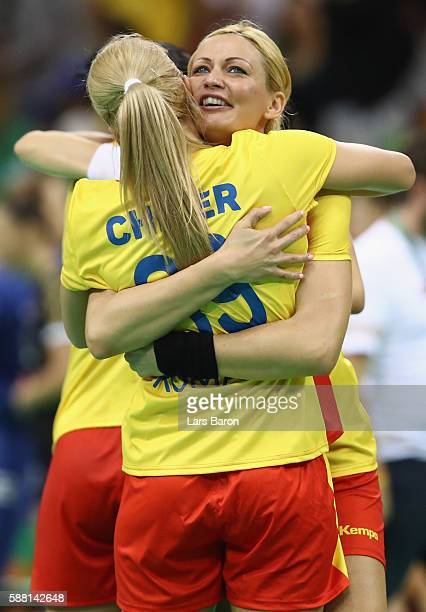 Gabriella Szucs of Romania celebrates with Laura Chiper of Romania after winning the Womens Preliminary Group A match between Romania and Montenegro...