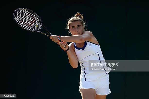 Gabriella Taylor of Great Britain hits a backhand during the girls' Singles first round match against Barbora Krejcikova of Czech Republic on day...