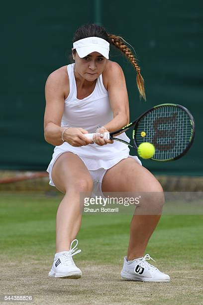 Gabriella Taylor of Great Britain plays a backhand during the Girl's singles first round match against Morgan Coppoc of The United States on Middle...