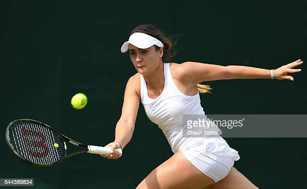 Gabriella Taylor of Great Britain plays a forehand during the Girl's singles first round match against Morgan Coppoc of The United States on Middle...