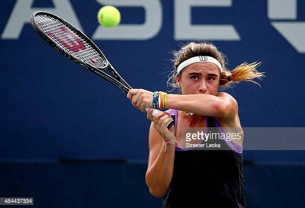 Gabriella Taylor of Great Britain returns a shot to Usue Maitane Arconada of the United States on Day Seven of the 2014 US Open at the USTA Billie...
