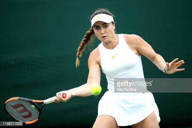 Gabriella Taylor of The United Kingdom plays a forehand during her ladies singles match against Chloe Paquet of France during qualifying prior to The...