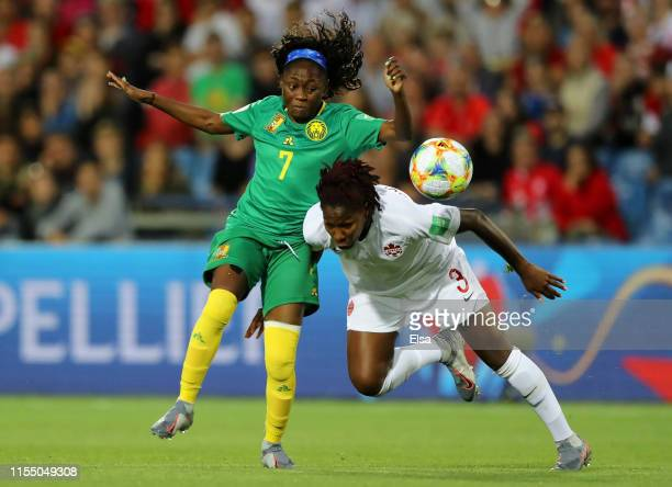 Gabrielle Aboudi Onguene of Cameroon battles for possession with Kadeisha Buchanan of Canada during the 2019 FIFA Women's World Cup France group E...