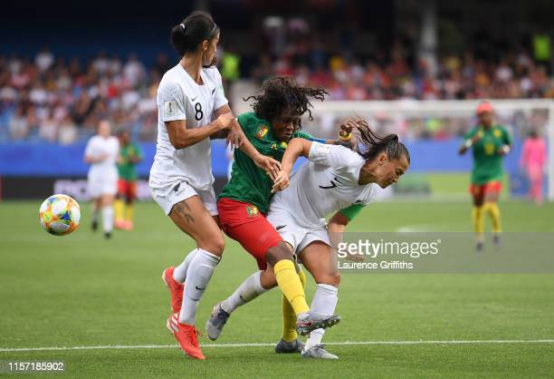 Gabrielle Aboudi Onguene of Cameroon clashes with Ali Riley and nzlduring the 2019 FIFA Women's World Cup France group E match between Cameroon and...
