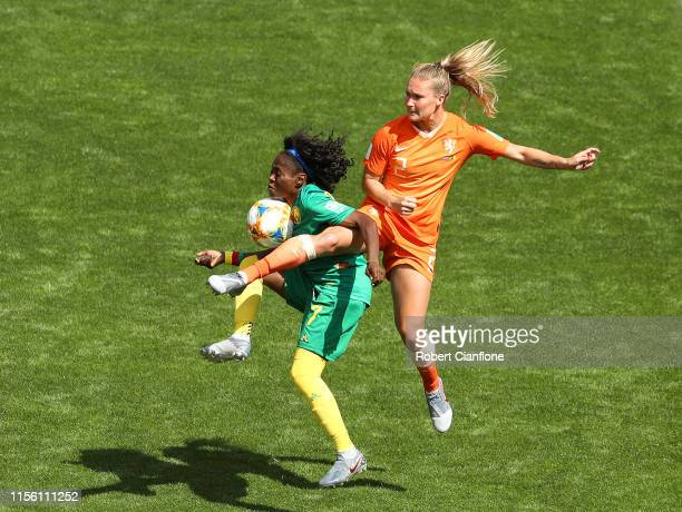 Gabrielle Aboudi Onguene of Cameroon is challenged by Desiree Van Lunteren of the Netherlands during the 2019 FIFA Women's World Cup France group E...