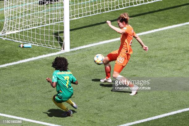 Gabrielle Aboudi Onguene of Cameroon puts the ball past Dominique Bloodworth during the 2019 FIFA Women's World Cup France group E match between...